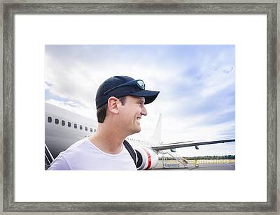 Smiling Travelling Man Standing On Airport Tarmac Framed Print by Jorgo Photography - Wall Art Gallery
