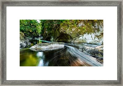 Smooth Flow Framed Print by Adrian Evans