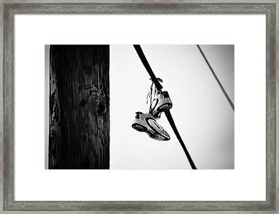Sneakers On Power Line Framed Print by Bill Cannon