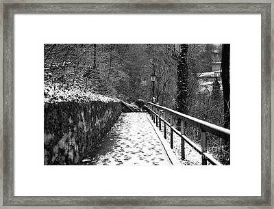 Snow On The Path In Salzburg Framed Print by John Rizzuto