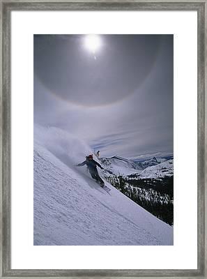 Snowboarding Down A Peak In Yosemite Framed Print by Bill Hatcher