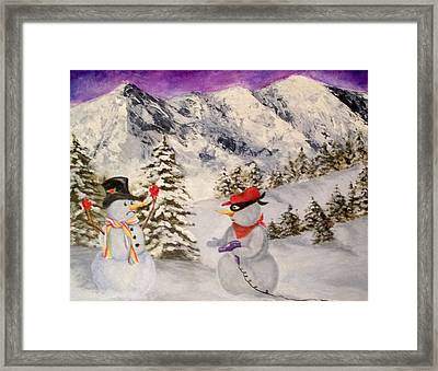 Snowie Hold-up Framed Print by Donna Tucker