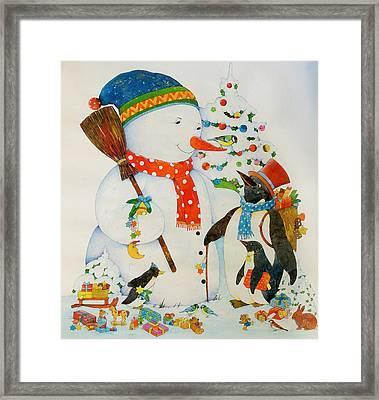 Snowman And Penguin Framed Print by Christian Kaempf