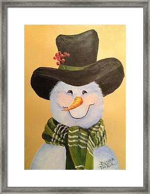 Snowman In Green Scarf Framed Print by Donna Tucker