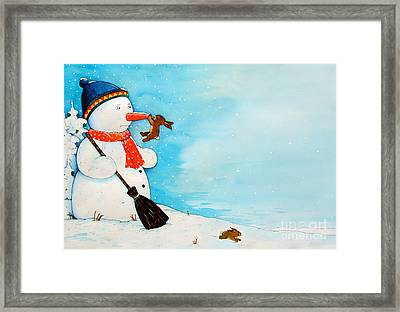 Snowman With Little Rabbit Framed Print by Christian Kaempf