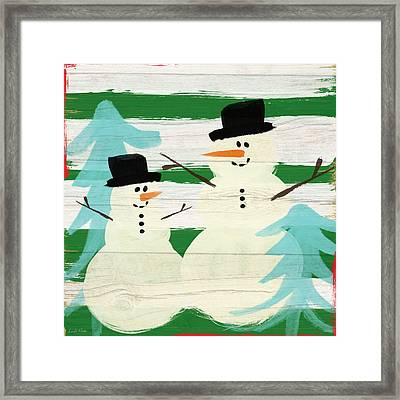 Snowmen With Blue Trees- Art By Linda Woods Framed Print by Linda Woods