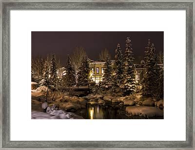 Snowy Night Along Blue River Framed Print by Michael J Bauer