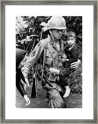 Soldier Carrying Boy Framed Print by Underwood Archives
