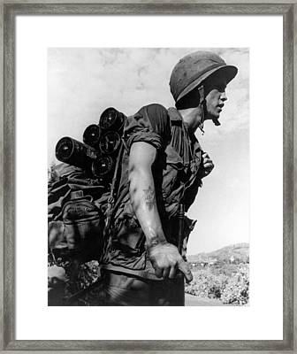 Soldier With A Heavy Load Framed Print by Underwood Archives