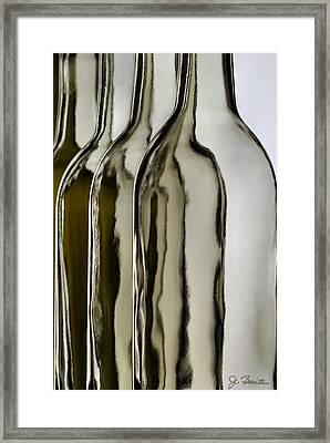 Somber Bottles Framed Print by Joe Bonita