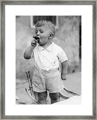 Sonny Smokes A Cigar Framed Print by Fpg