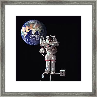 Spacewalk Earth Framed Print by Daniel Hagerman