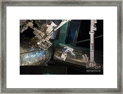 Spacewalk On Iss Framed Print by NASA/Science Source