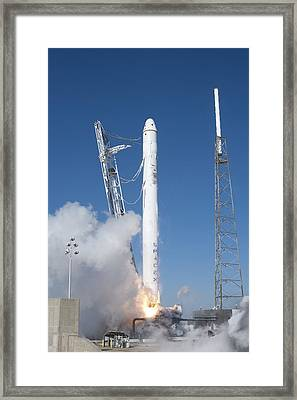 Spacex�s Falcon 9 Rocket And Dragon Framed Print by Everett