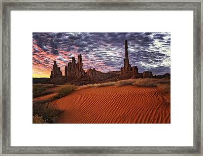 Spectacular Sunrise Over The Totem Pole And Yei Bi Chei Rock Formations. Framed Print by Larry Geddis