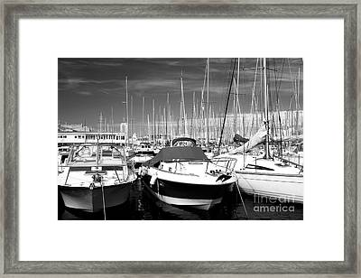 Speed In The Port Framed Print by John Rizzuto