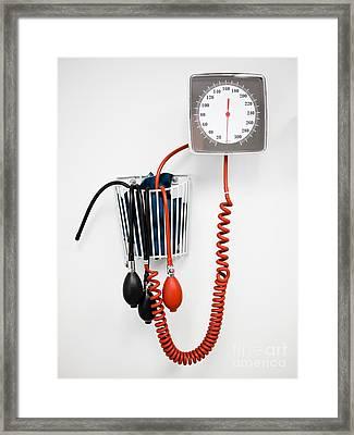 Sphygmomanometer Blood Pressure Gauge In A Doctor's Office Framed Print by Paul Velgos