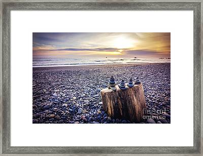 Stacked Rocks At Sunset Framed Print by Joan McCool