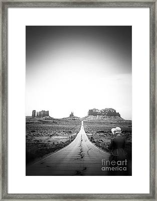 Stepping Into The Future Framed Print by Jimmy Ostgard
