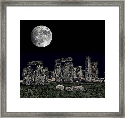 Stonehenge Moon Framed Print by Daniel Hagerman