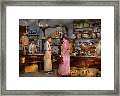 Store - In A General Store 1917 Framed Print by Mike Savad