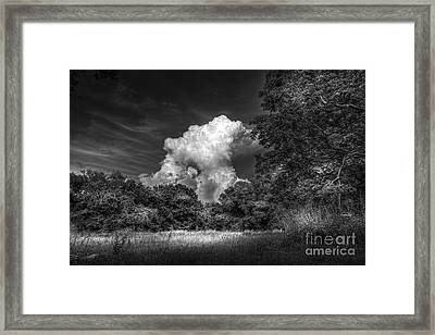 Storm Beyond The Meadow Framed Print by Marvin Spates
