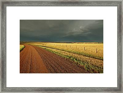 Storm Clouds Along A Saskatchewan Country Road Framed Print by Mark Duffy