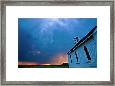 Storm Clouds Over Saskatchewan Country Church Framed Print by Mark Duffy