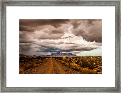 Storm Rolling Into The Superstition Mountains Framed Print by Chuck Brown
