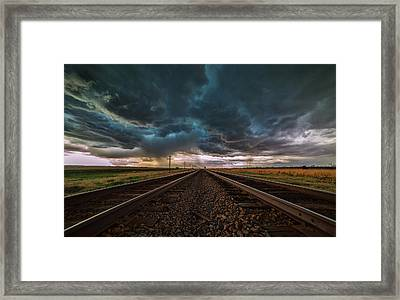 Storm Tracks Framed Print by Darren  White