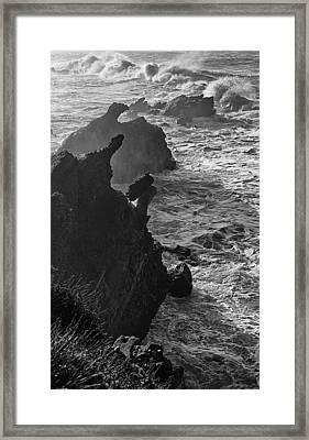 Stormy Shoreline Framed Print by Ron Regalado