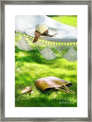 Straw Hat With Brown Ribbon Laying On Hammock Framed Print by Sandra Cunningham