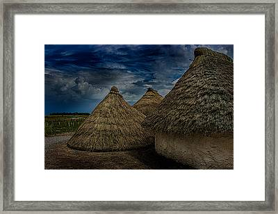 Straw Huts Framed Print by Martin Newman