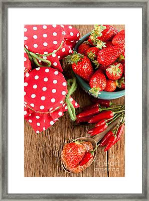 Strawberry And Chilli Jam On A Rustic Wooden Table Framed Print by Wolfgang Steiner