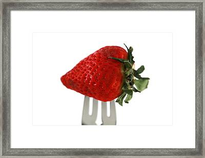 Strawberry On A Fork Framed Print by Michael Ledray