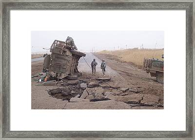 Stryker Vehicle Lies On Its Side Framed Print by Everett
