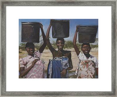 Sudanese Women Coming From The Borehole Framed Print by Leonor Thornton