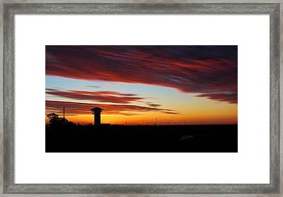 Sunrise Over Golden Spike Tower Framed Print by Bill Kesler