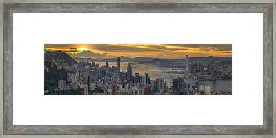 Sunrise Over Hong Kong And Kowloon City Framed Print by Anek Suwannaphoom