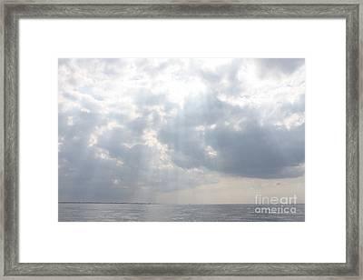 Suns Rays Over The Atlantic Ocean Framed Print by John Telfer