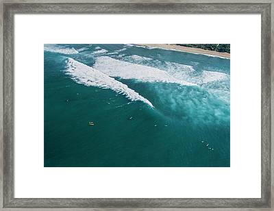 Sunset Beach Lining Up Framed Print by Sean Davey