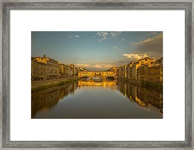 Sunset Light On The Ponte Vecchio Bridge Framed Print by Chris Fletcher