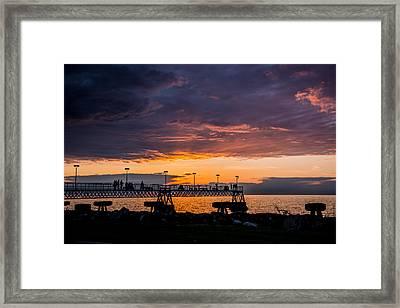 Sunset On Edgewater Park Pier Framed Print by Paul Evans