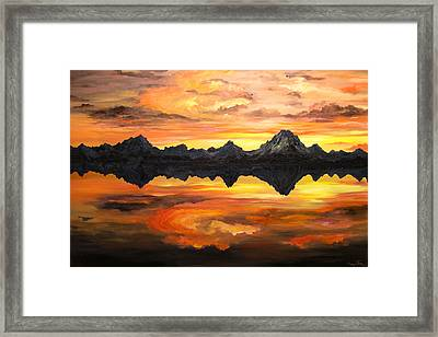 Sunset Over Jackson Lake And The Grand Tetons Framed Print by Connie Tom