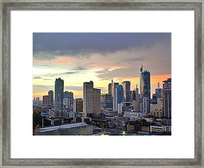 Sunset Over  Makati City, Manila Framed Print by Neil Howard
