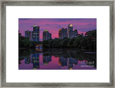 Sunset Over Midtown Framed Print by Doug Sturgess