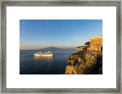 Sunset Postcard From Sorrento - The Sea The Cliffs And Vesuvius Volcano Behind The Criuse Ship Framed Print by Georgia Mizuleva