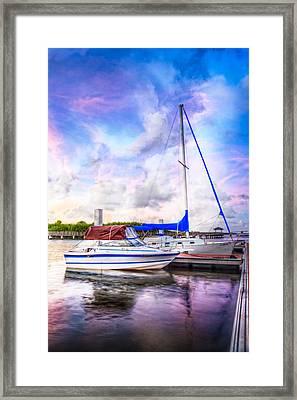 Sunset Sailboats Framed Print by Debra and Dave Vanderlaan