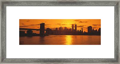 Sunset Skyline New York City Ny Usa Framed Print by Panoramic Images