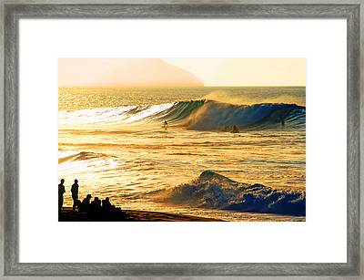 Sunset Surfers Framed Print by Kevin Smith